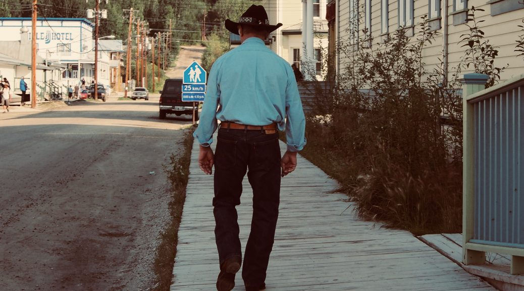 An old cowboy on the boards in Dawson City,Yukon, Canada