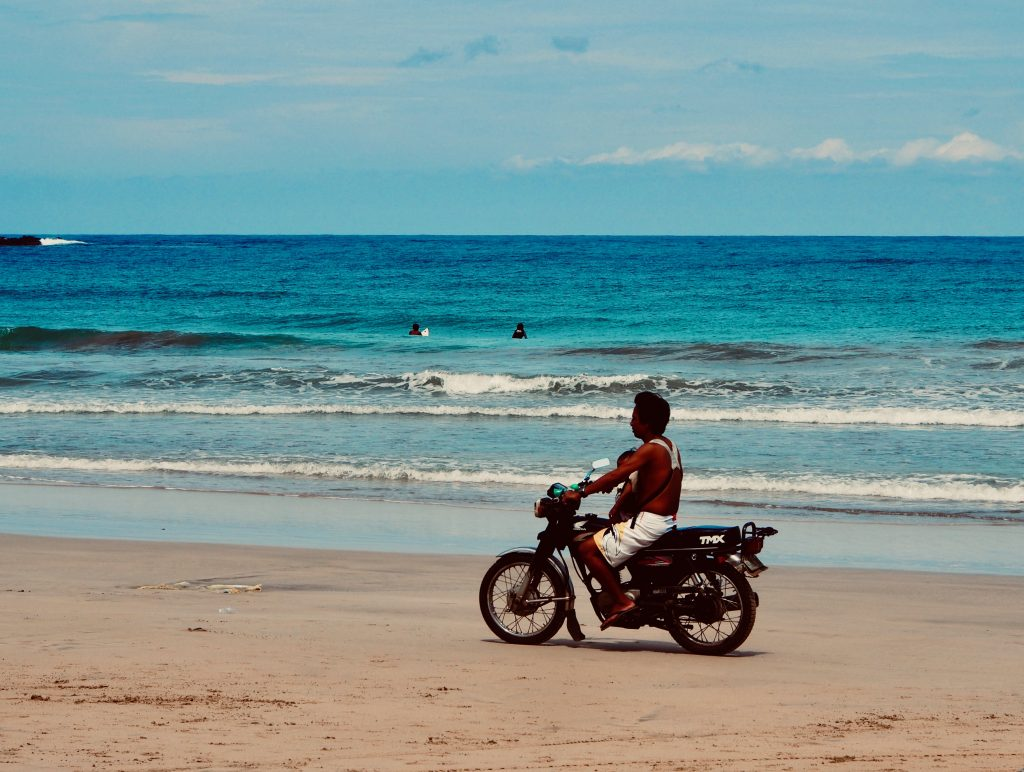 Motorbike and surfers,Palawan ,Phillipines ,S.E. Asia