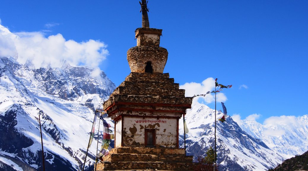 A sacred stuppa with mountain background on the Annapurna Trail in Nepal.