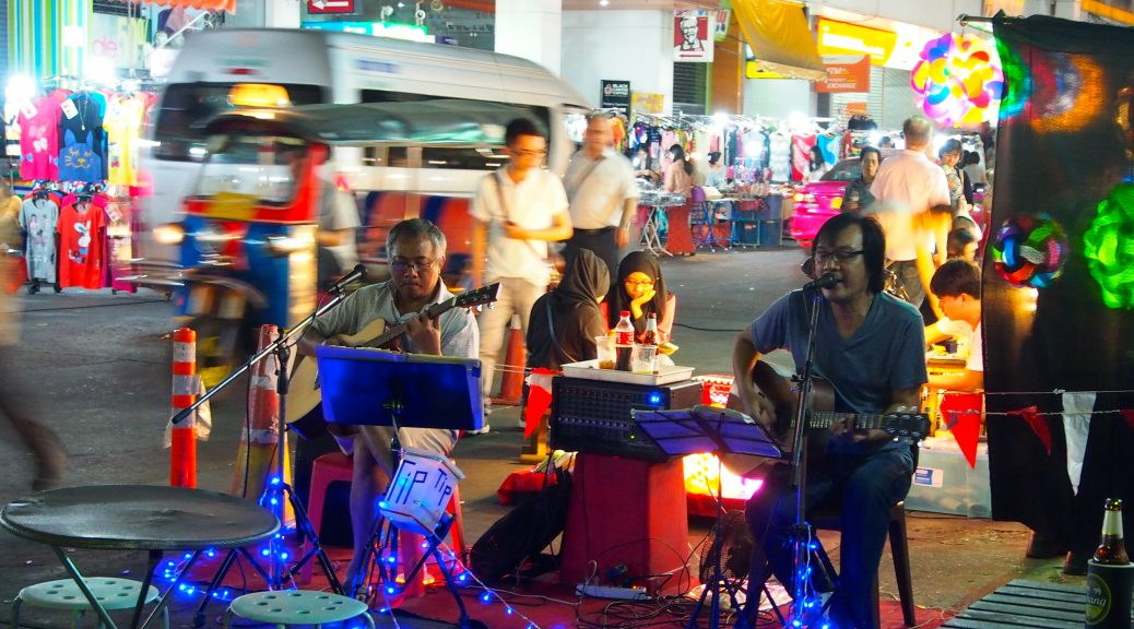 Musicians playing on the street in Asia.