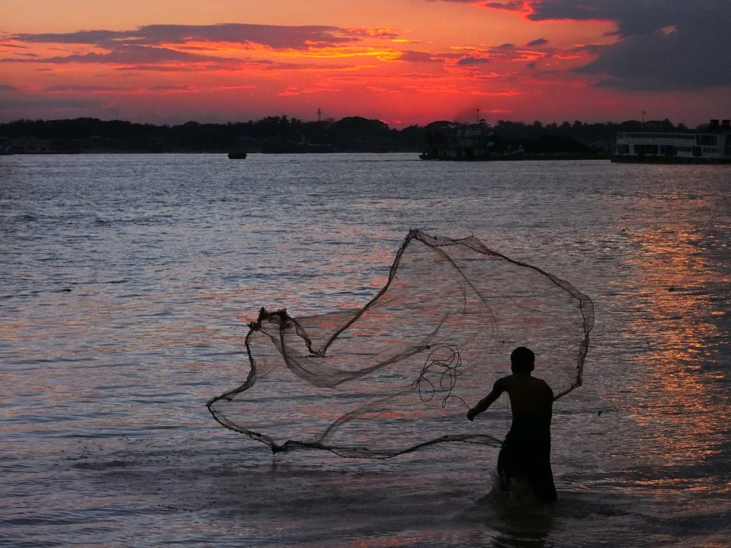 Man throwing a fishing net, Yangon,Myanmar.