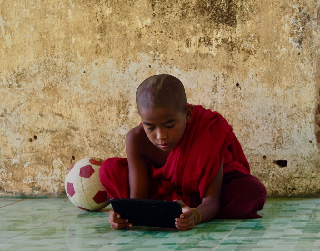 The internet has penetrated millions of lives including this young monk on his device